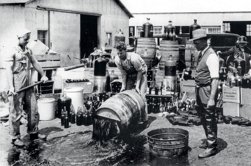 Alcohol-supplies-being-destroyed-during-the-Prohibition-period-1220x807.jpg